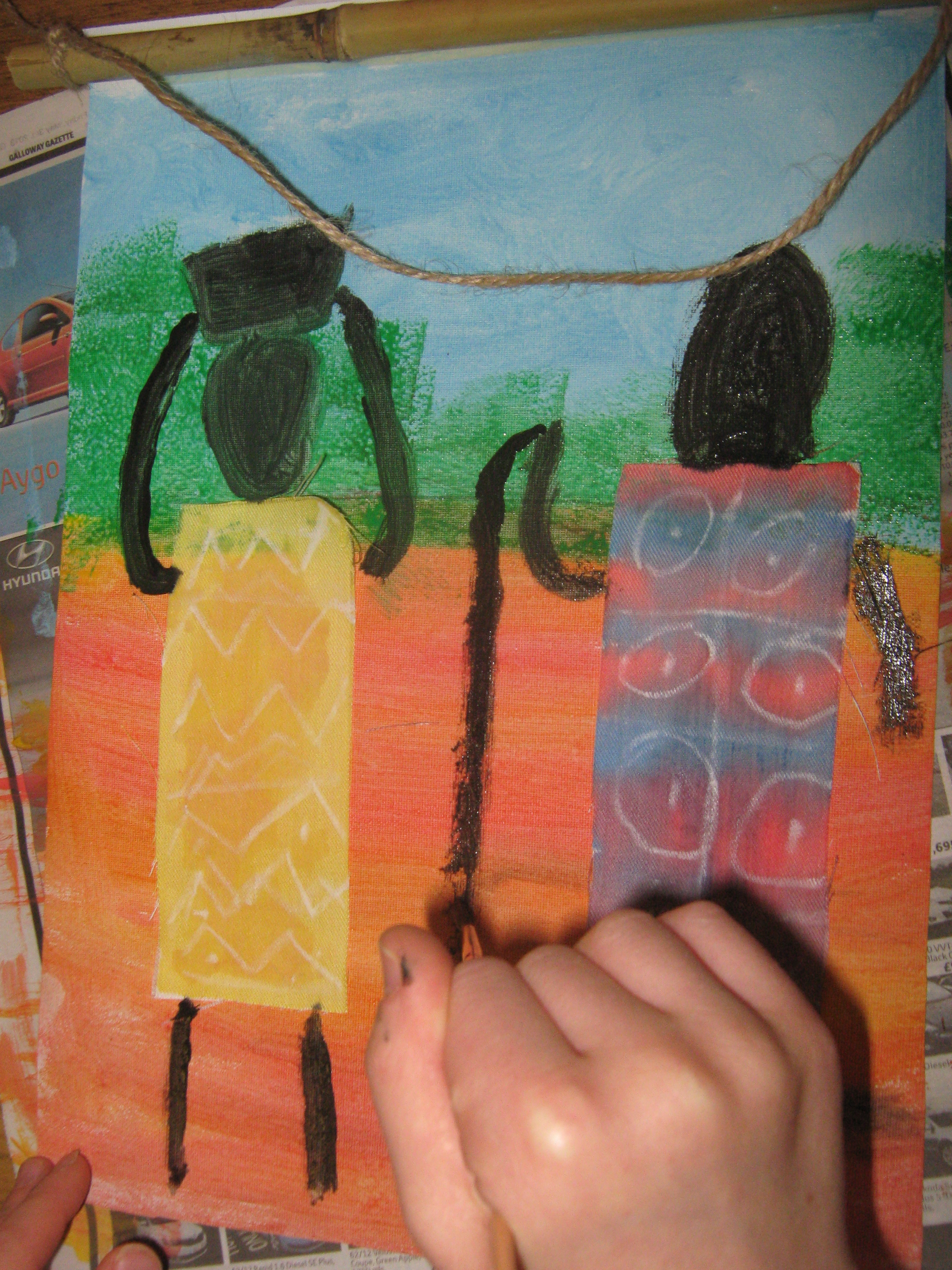 Paint an African wall-hanging